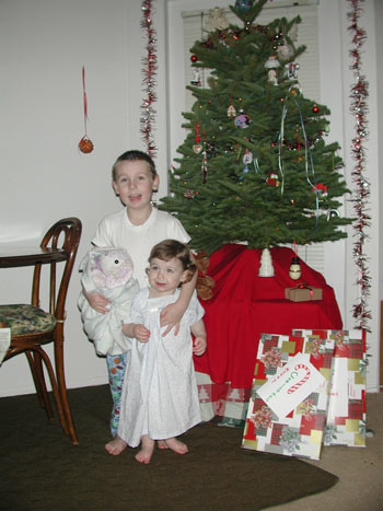 The kids next to the tree in their new homemade PJs (a family tradition) Christmas Eve
